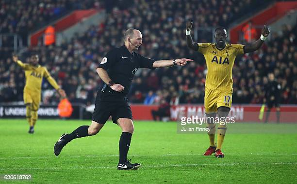 Referee Mike Dean signals as he awards Spurs a penalty kick during the Premier League match between Southampton and Tottenham Hotspur at St Mary's...