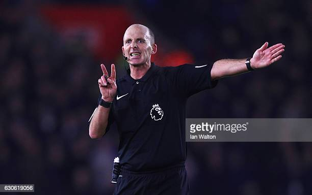 Referee Mike Dean signals during the Premier League match between Southampton and Tottenham Hotspur at St Mary's Stadium on December 28 2016 in...