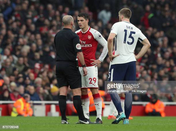 Referee Mike Dean speaks to Arsenal's Granit Xhaka during the Premier League match at the Emirates Stadium London