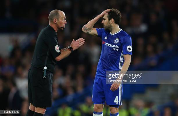 Referee Mike Dean speaks with Cesc Fabregas of Chelsea during the Premier League match between Chelsea and Manchester City at Stamford Bridge on...