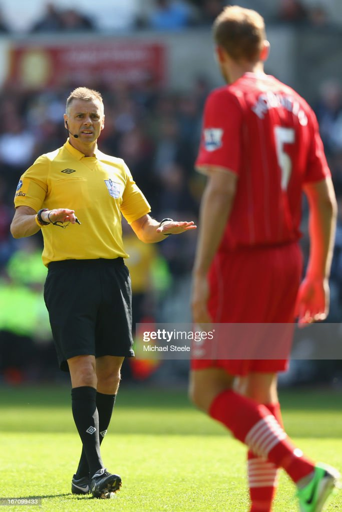 Referee Mike Halsey (L) explains a decision as he looks towards Jos Hooiveld (R) of Southampton during the Barclays Premier League match between Swansea City and Southampton at the Liberty Stadium on April 20, 2013 in Swansea, Wales.