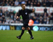 Referee Mike Jones during the Barclays Premier League match between Newcastle United and Southampton at St James' Park on December 14 2013 in...