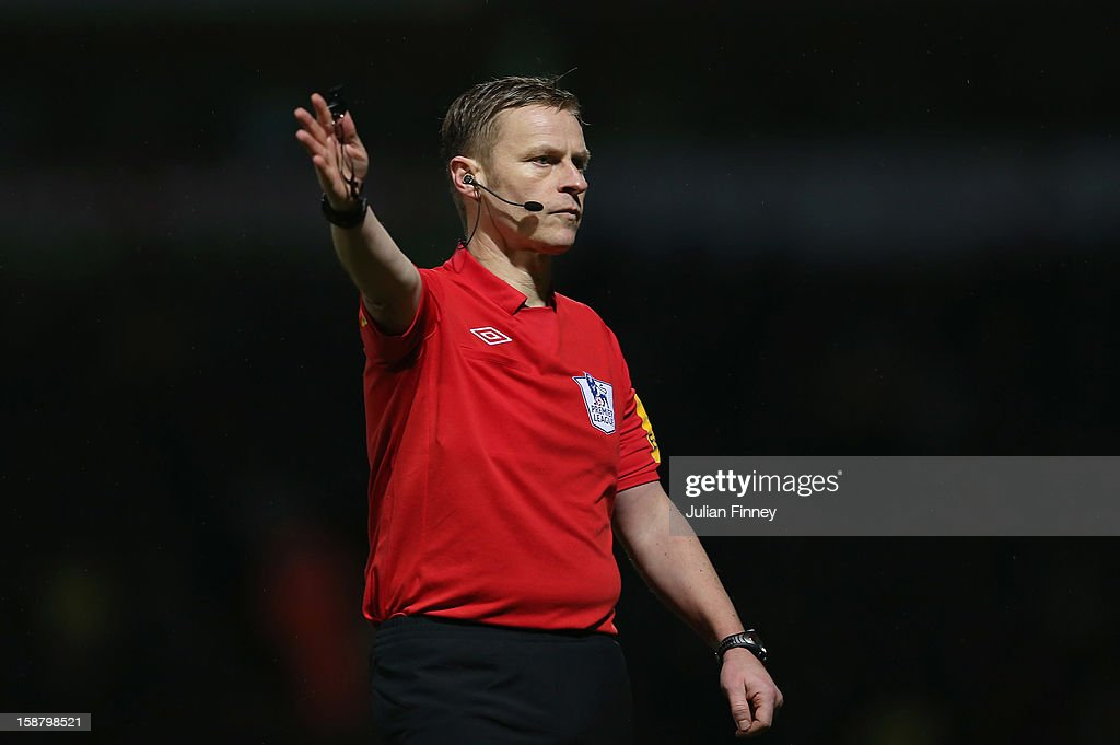 Referee Mike Jones gestures during the Barclays Premier League match between Norwich City and Manchester City at Carrow Road on December 29, 2012 in Norwich, England.