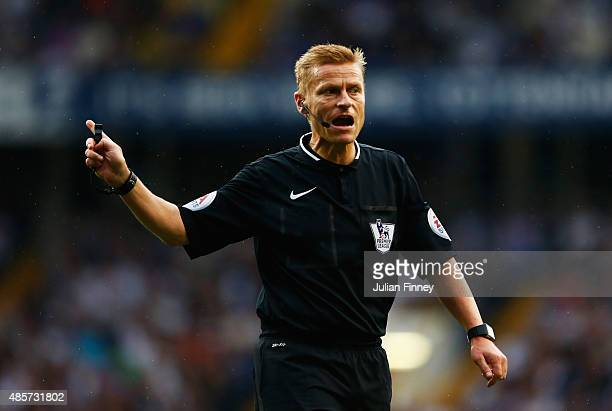 Referee Mike Jones gestures during the Barclays Premier League match between Tottenham Hotspur and Everton at White Hart Lane on August 29 2015 in...