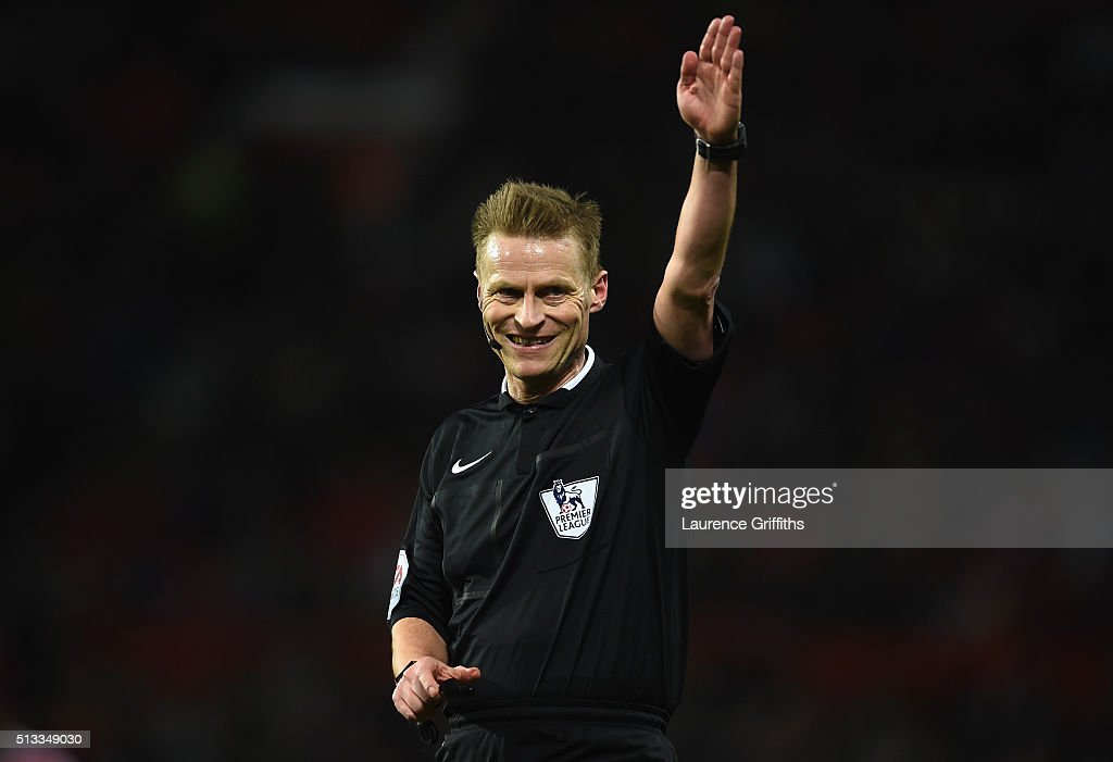 Referee <a gi-track='captionPersonalityLinkClicked' href=/galleries/search?phrase=Mike+Jones+-+Referee&family=editorial&specificpeople=7275880 ng-click='$event.stopPropagation()'>Mike Jones</a> gestures during the Barclays Premier League match between Manchester United and Watford at Old Trafford on March 2, 2016 in Manchester, England.