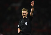 Referee Mike Jones gestures during the Barclays Premier League match between Manchester United and Watford at Old Trafford on March 2 2016 in...