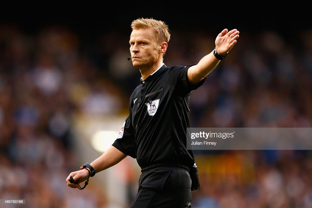 Referee <a gi-track='captionPersonalityLinkClicked' href=/galleries/search?phrase=Mike+Jones+-+Referee&family=editorial&specificpeople=7275880 ng-click='$event.stopPropagation()'>Mike Jones</a> gives a decision during the Barclays Premier League match between Tottenham Hotspur and Everton at White Hart Lane on August 29, 2015 in London, United Kingdom.