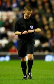 Referee Mike Jones looks at his watch during the Barclays Premier League match between Sunderland and Aston Villa at Stadium of Light on January 1...
