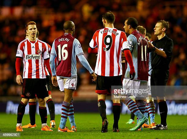 Referee Mike Jones looks on as Jack Colback of Sunderland clashes with Gabriel Agbonlahor of Aston Villa during the Barclays Premier League match...
