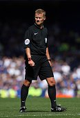 Referee Mike Jones looks on during the Barclays Premier League match between Everton and Watford at Goodison Park on August 8 2015 in Liverpool...
