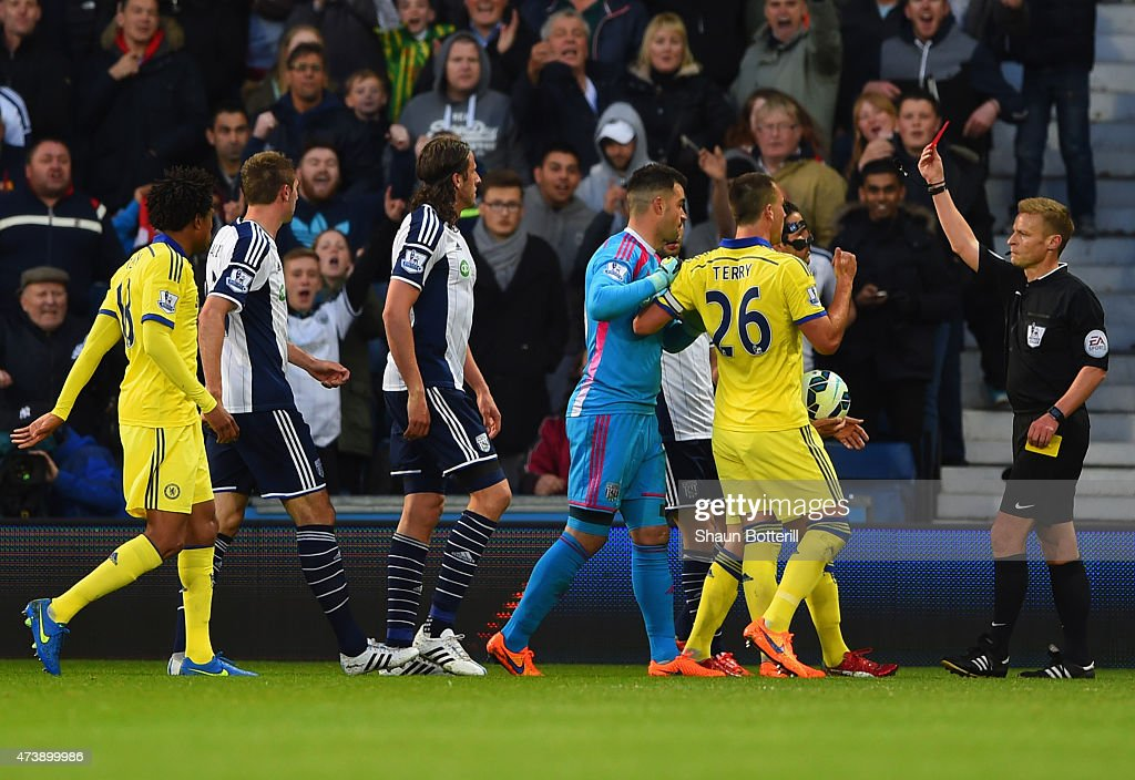 Referee Mike Jones shows a red card to Cesc Fabregas of Chelsea (obscured 2R) as he is sent off during the Barclays Premier League match between West Bromwich Albion and Chelsea at The Hawthorns on May 18, 2015 in West Bromwich, England.