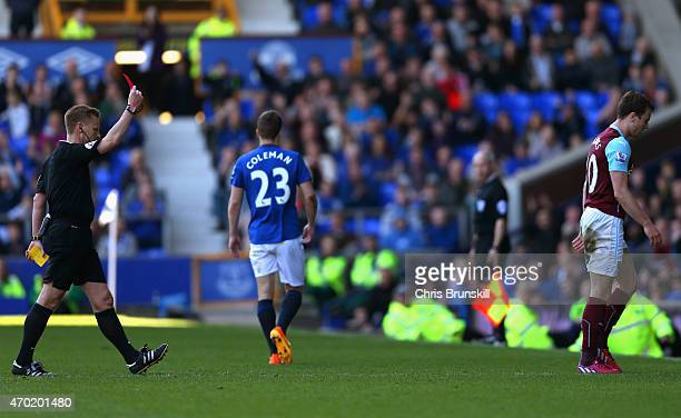 Referee Mike Jones shows Ashley Barnes of Burnley a red card during the Barclays Premier League match between Everton and Burnley at Goodison Park on...