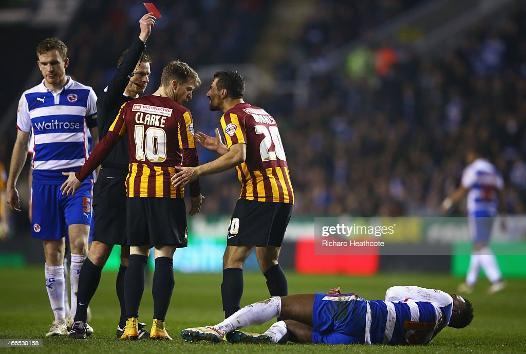 Referee Mike Jones shows the red card to Filipe Morais of Bradford City during the FA Cup Quarter Final Replay match between Reading and Bradford City at Madejski Stadium on March 16, 2015 in Reading, England.