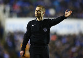 Referee Mike Jones signals during the FA Cup Quarter Final Replay match between Reading and Bradford City at Madejski Stadium on March 16 2015 in...