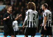Referee Mike Jones speaks with Fabrizio Coloccini and Michael Williamson of Newcastle United during the Barclays Premier League match between...