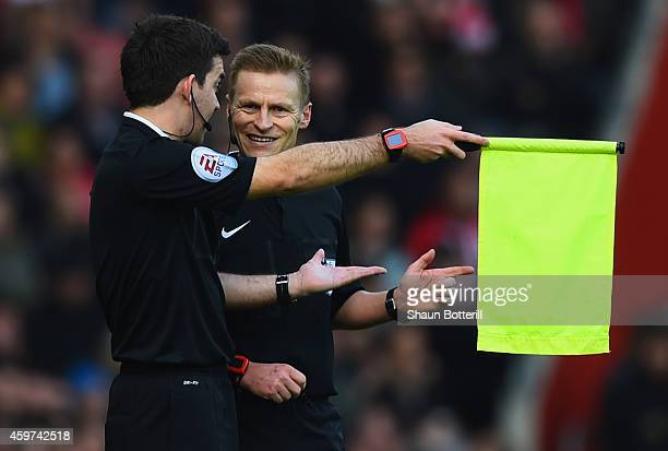 Referee Mike Jones talks to his assistant referee during the Barclays Premier League match between Southampton and Manchester City at St Mary's...