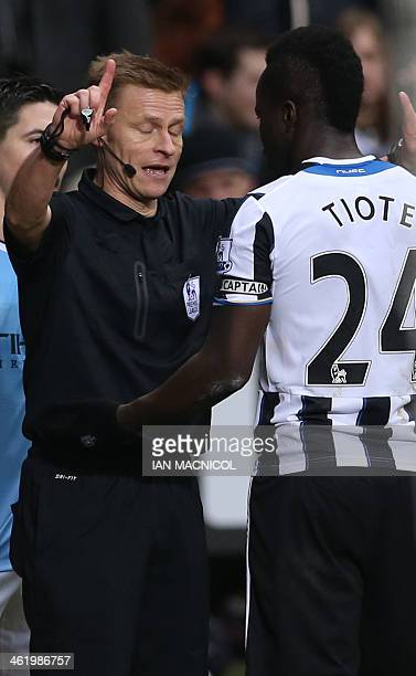 Referee Mike Jones talks to Newcastle United's Ivorian midfielder Cheick Tiote during the English Premier League football match between Newcastle...