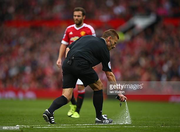 Referee Mike Jones uses a vanishing sprey during the Barclays Premier League match between Manchester United and Sunderland at Old Trafford on...