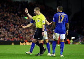 Referee Mike Jones waves away Leicester players as he awards a second penalty to Liverpool during the Barclays Premier League match between Liverpool...