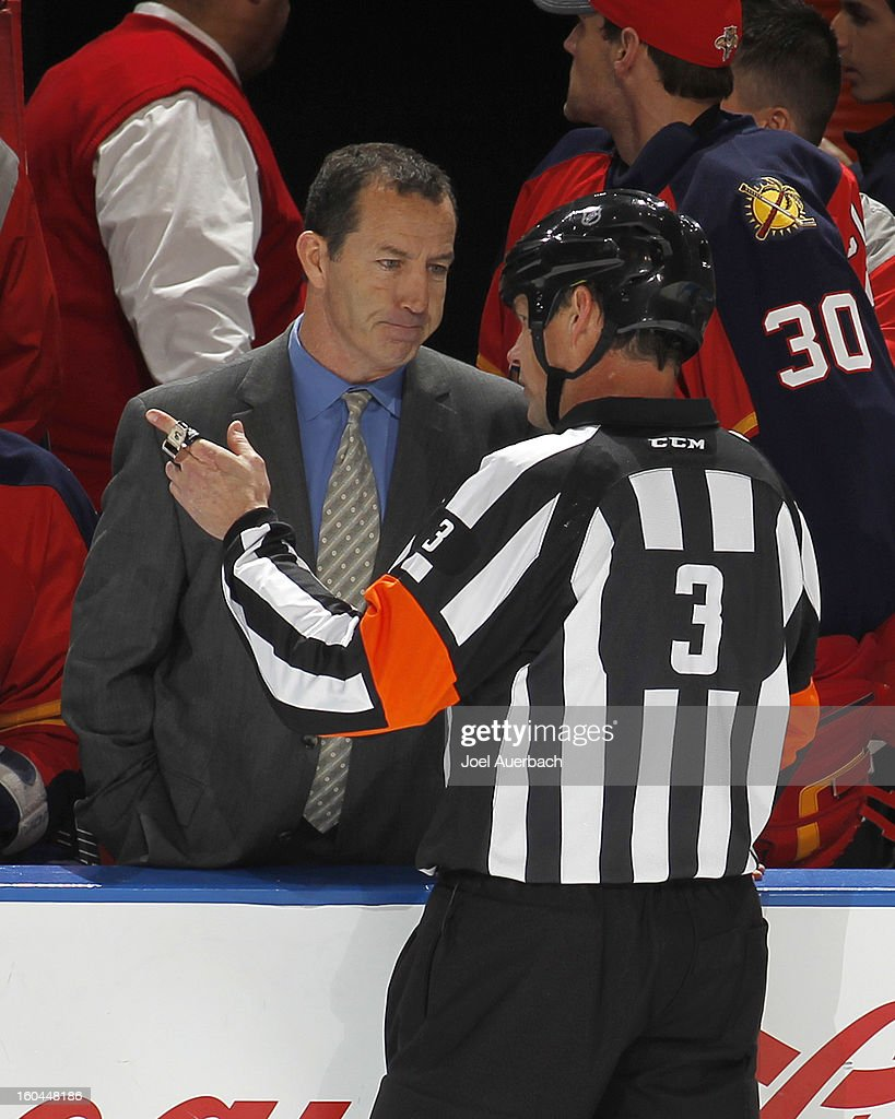Referee Mike Leggo #3 explains the fighting penalty to head coach Kevin Dineen of the Florida Panthers in the third period against the Winnipeg Jets at the BB&T Center on January 31, 2013 in Sunrise, Florida. The Panthers defeated the Jets 6-3.
