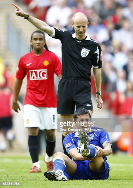 Referee Mike Riley gives a free kick following a challenge by Everton's Tim Cahill