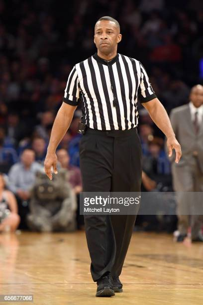 Referee Mike Roberts looks on during the Big East Basketball Tournament First Round game between the St John's Red Storm and the Georgetown Hoyas at...