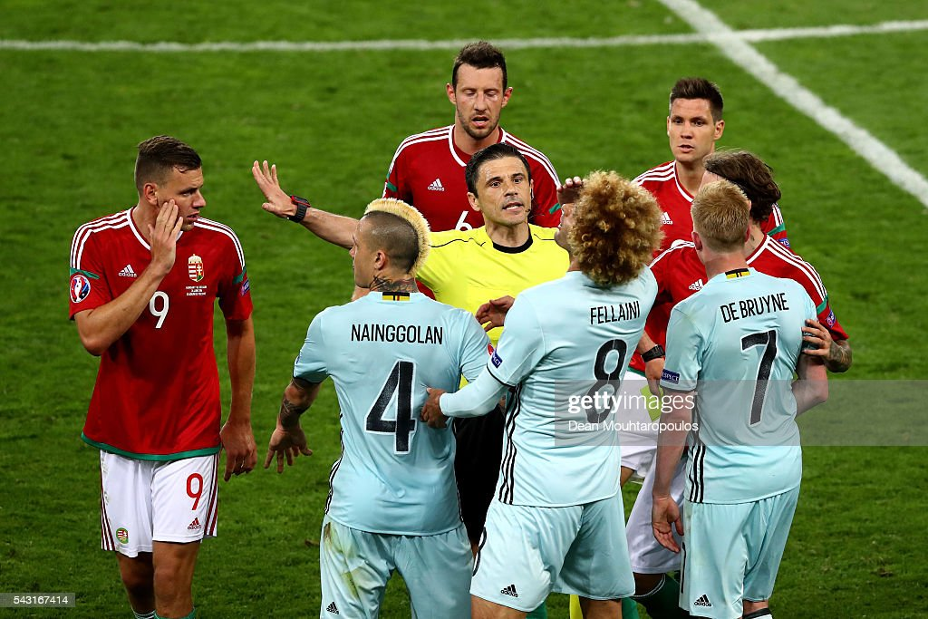 Referee Milorad Mazic and players try to separate argued <a gi-track='captionPersonalityLinkClicked' href=/galleries/search?phrase=Adam+Szalai&family=editorial&specificpeople=2344504 ng-click='$event.stopPropagation()'>Adam Szalai</a> (1st L) of Hungary and <a gi-track='captionPersonalityLinkClicked' href=/galleries/search?phrase=Marouane+Fellaini&family=editorial&specificpeople=3936316 ng-click='$event.stopPropagation()'>Marouane Fellaini</a> (3rd R) of Belgium during the UEFA EURO 2016 round of 16 match between Hungary and Belgium at Stadium Municipal on June 26, 2016 in Toulouse, France.