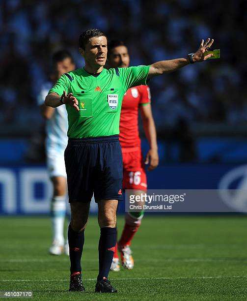 Referee Milorad Mazic gestures during the 2014 FIFA World Cup Brazil Group F match between Argentina and Iran at Estadio Mineirao on June 21 2014 in...