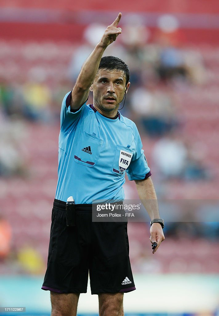 Referee Milorad Mazic gestures during the FIFA U-20 World Cup Group C match between Colombia and Australia at Huseyin Avni Aker Stadium on June 22, 2013 in Trabzon, Turkey.