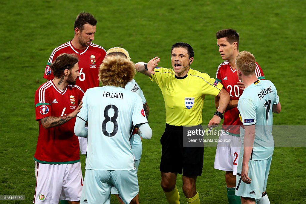 Referee Milorad Mazic (3rd R) prepares to show an yellow card to <a gi-track='captionPersonalityLinkClicked' href=/galleries/search?phrase=Marouane+Fellaini&family=editorial&specificpeople=3936316 ng-click='$event.stopPropagation()'>Marouane Fellaini</a> (3rd L) of Belgium during the UEFA EURO 2016 round of 16 match between Hungary and Belgium at Stadium Municipal on June 26, 2016 in Toulouse, France.