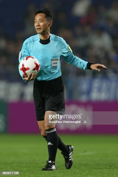 Referee Minoru Tojo replaces the matchball during the JLeague J1 match between Gamba Osaka and Sanfrecce Hiroshima at Suita City Football Stadium on...