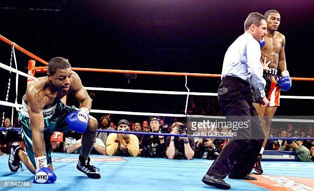 Referee Mitch Halpern directs Felix Trinidad of Cupey Puerto Rico to a neutral corner after Trinidad knocked David Reid of Philadelphia PA down for...