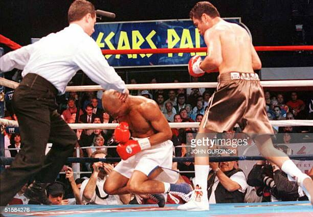 Referee Mitch Halpern rushes in to stop the fight as Darryl Tyson of Washington DC falls to the canvas after a flurry of punches from Oscar De La...