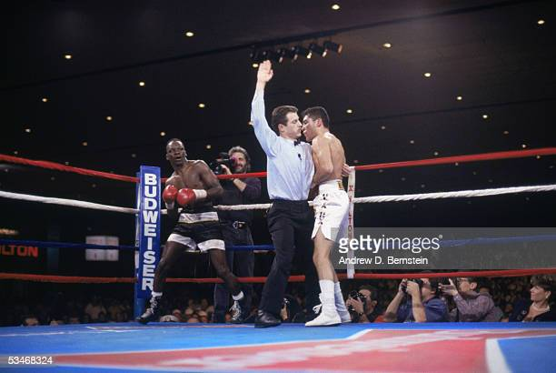Referee Mitch Halpern stand bewteen Oscar De La Hoya and Jeff Mayweather during a fight on March 13 1993 at the Hilton Hotel in Las Vegas Nevada De...