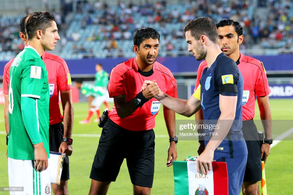 Referee Mohammed Abdullah Hassan shakes hands with Lewis Cook of England before the FIFA U-20 World Cup Korea Republic 2017 Quarter Final match between Mexico and England at Cheonan Baekseok Stadium on June 5, 2017 in Cheonan, South Korea.