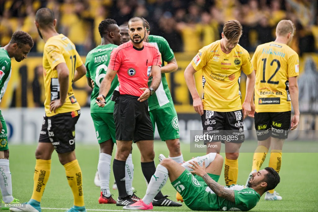 Referee Mohammed Al-Hakim inspects Jiloan Hamad of Hammarby IF who's in pain during the Allsvenskan match between IF Elfsborg and Hammarby at Boras Arena on July 17, 2017 in Boras, Sweden.