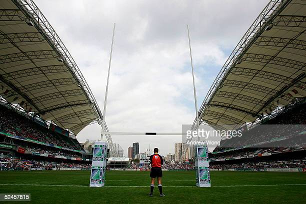 A referee monitors a match on day three of the Rugby World Cup Sevens held at Hong Kong Stadium March 20 2005 in Hong Kong China