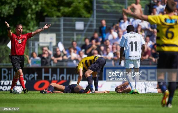 Referee Morten Krogh calls for assistance when Yaw Amankwah of Hobro IK and Bjarke Jacobsen of Vendsyssel FF are injured during the Danish NordicBet...