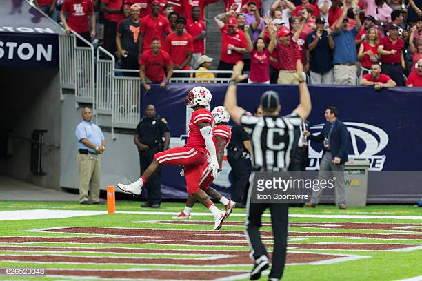 Referee motions touchdown as Houston Cougars cornerback Brandon Wilson return the ball 109 yards on a missed field goal by Oklahoma Sooners kicker...
