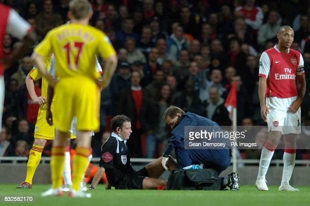 Referee Mr M Clattenburg receives treatment for an injury