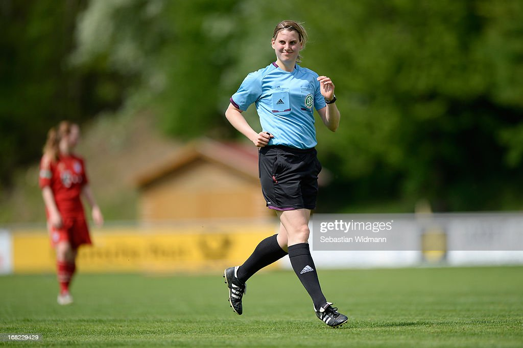Referee Nathalie Eisenhardt smiles during the B Junior Girls match between Bayern Muenchen and VfL Sindelfingen at Sportpark Aschheim on May 4, 2013 in Aschheim, Germany.