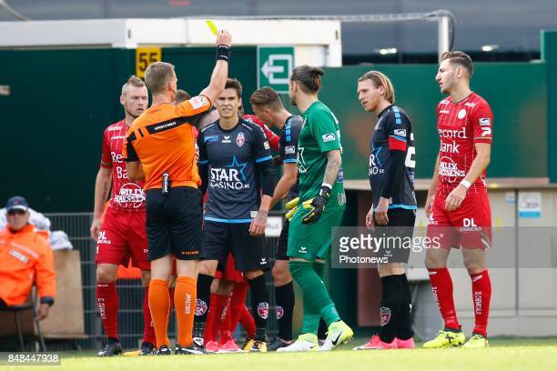 referee Nathan Verboomen and Logan Bailly goalkeeper of Royal Excel Mouscron pictured during the Jupiler Pro League match between Zulte Waregem and...
