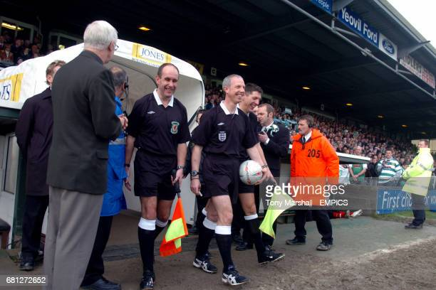 Referee Neale Barry leads out the two teams with Assistant referee's DC Richards and A Garratt