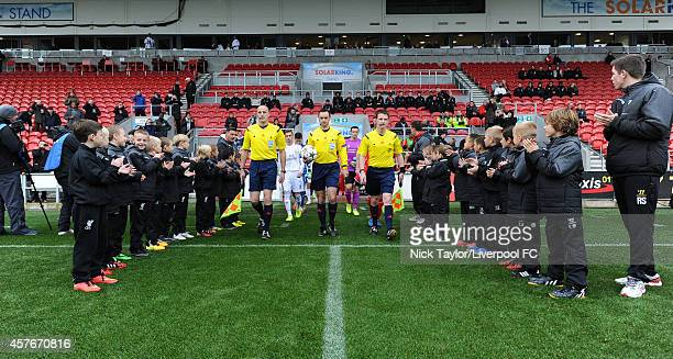 Referee Neil Doyle and his assistants Emmet Dynan and Darragh Keegan lead the teams onto the pitch for the UEFA Youth Champions League fixture...