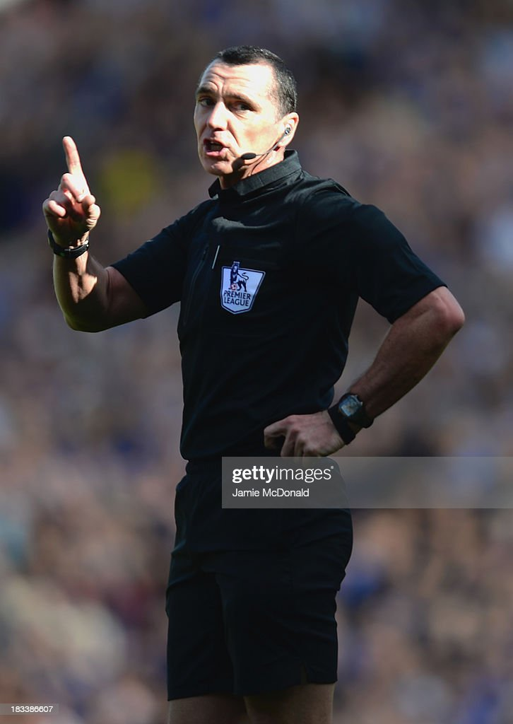 Referee Neil Swarbrick gestures during the Barclays Premier League match between Norwich City and Chelsea at Carrow Road on October 6, 2013 in Norwich, England.