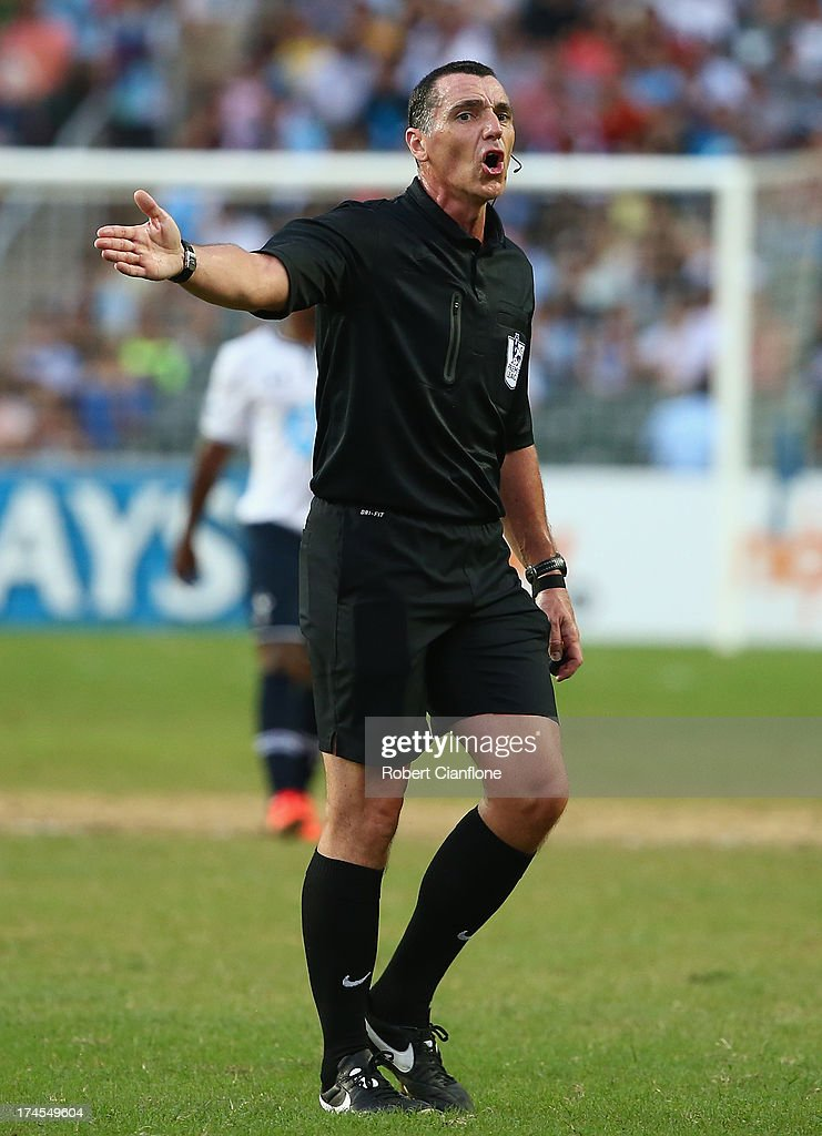 Referee Neil Swarbrick gestures during the Third Place Play-Off match between Tottenham Hotspur and South China at Hong Kong Stadium on July 27, 2013 in So Kon Po, Hong Kong.