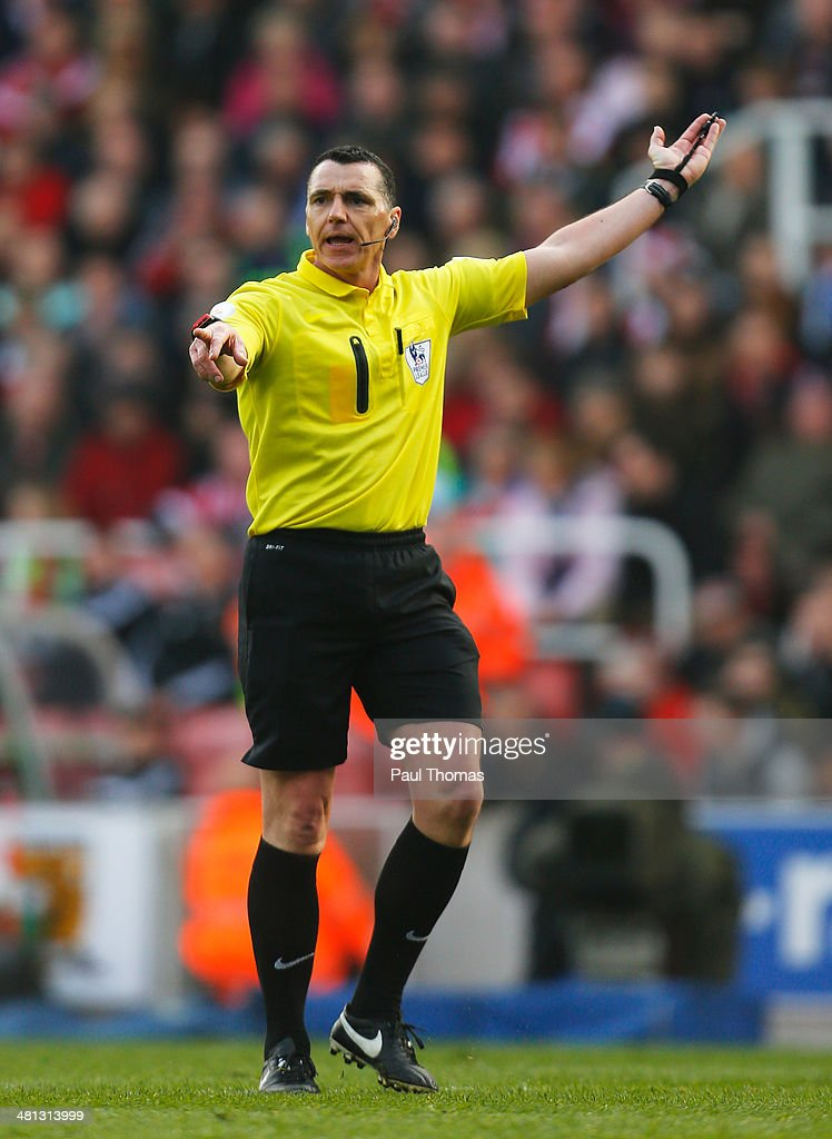 Referee Neil Swarbrick looks on during the Barclays Premier League match between Stoke City and Hull City at Britannia Stadium on March 29, 2014 in Stoke on Trent, England.