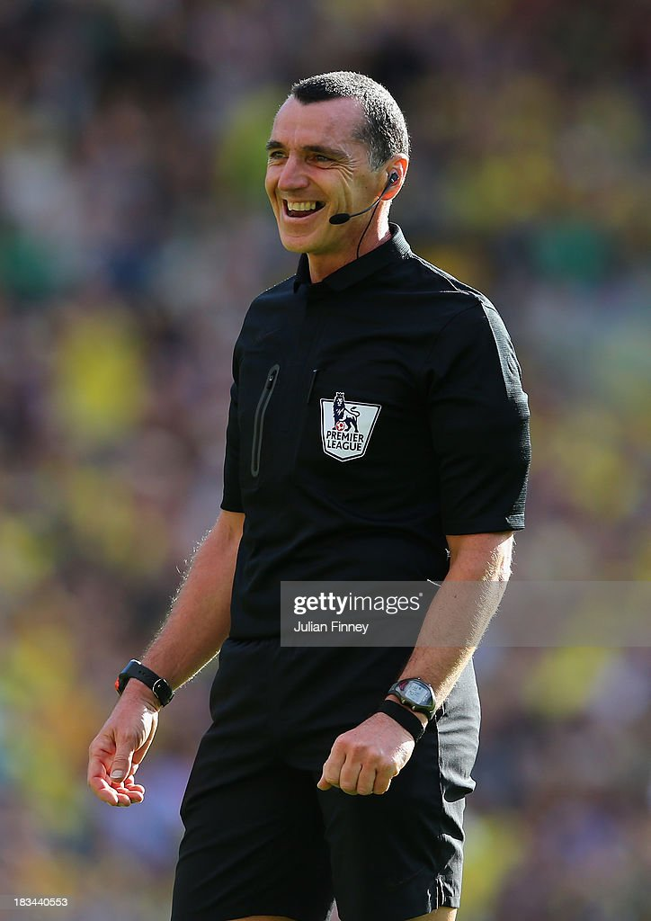 Referee, Neil Swarbrick smiles during the Barclays Premier League match between Norwich City and Chelsea at Carrow Road on October 6, 2013 in Norwich, England.