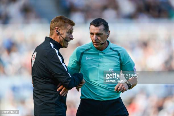 Referee Neil Swarbrick talks to Fourth Official Mike Jones during the Premier League Match between Newcastle United and West Ham United at StJames'...