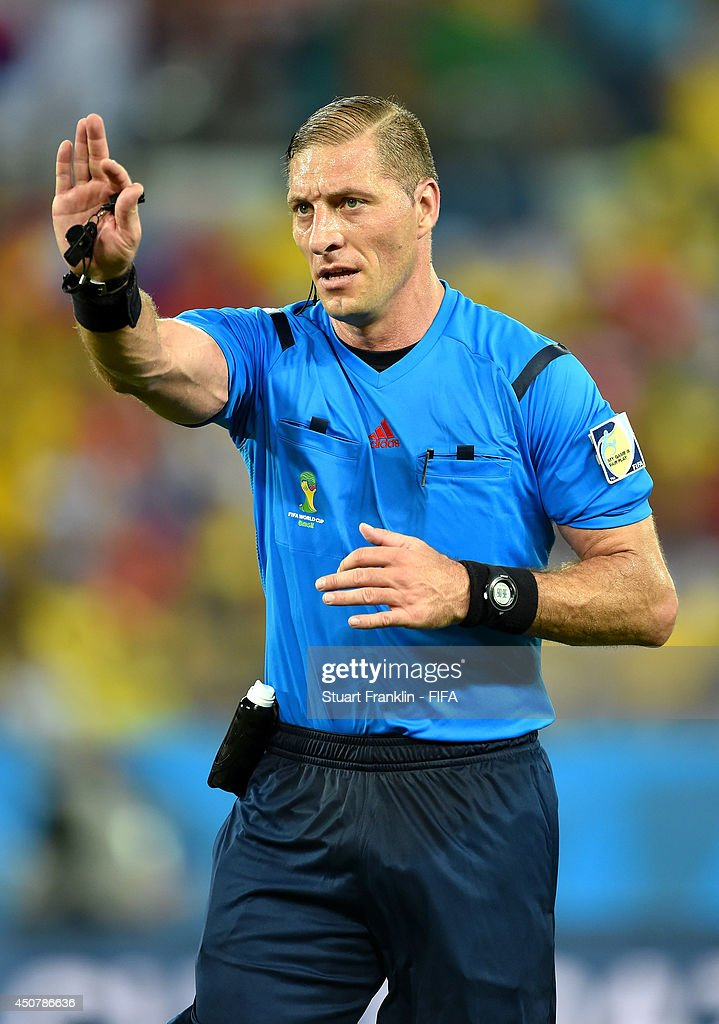 Referee Nestor Pitana gestures during the 2014 FIFA World Cup Brazil Group H match between Russia and Korea Republic at Arena Pantanal on June 17, 2014 in Cuiaba, Brazil.